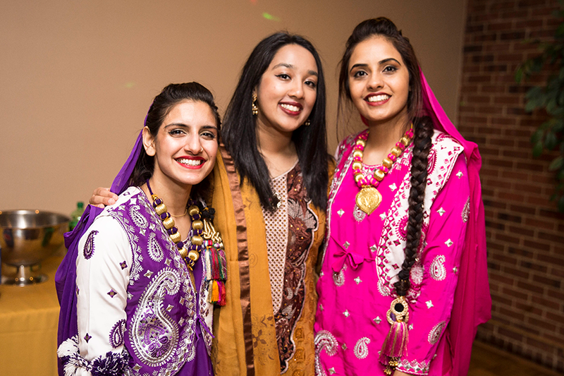 Adelphi students wearing traditional attire